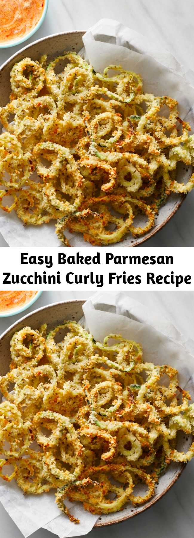 Easy Baked Parmesan Zucchini Curly Fries Recipe - This healthy recipe combines two bar food favorites--fried zucchini and curly fries--into one tempting package. Serve these baked zucchini fries with a simple dipping sauce made with ranch dressing and marinara sauce for a crowd-pleasing appetizer or a side dish for burgers, chicken or pizza. No matter what you serve them with, they're a fun way to eat more vegetables for kids and adults alike. #comfortfood #healthycomfortfood #recipe #healthy