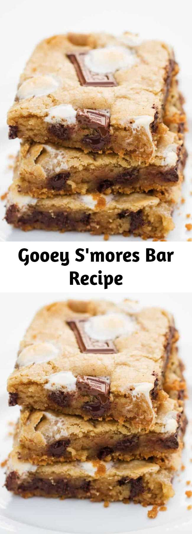 Gooey S'mores Bar Recipe - Gooey s'mores bars filled with a graham cracker crust and loaded with chocolate chips, marshmallows and chocolate candy bar pieces. The ultimate cookie bar recipe that is out of this world! It's not summer time without some sort of s'mores dessert!!