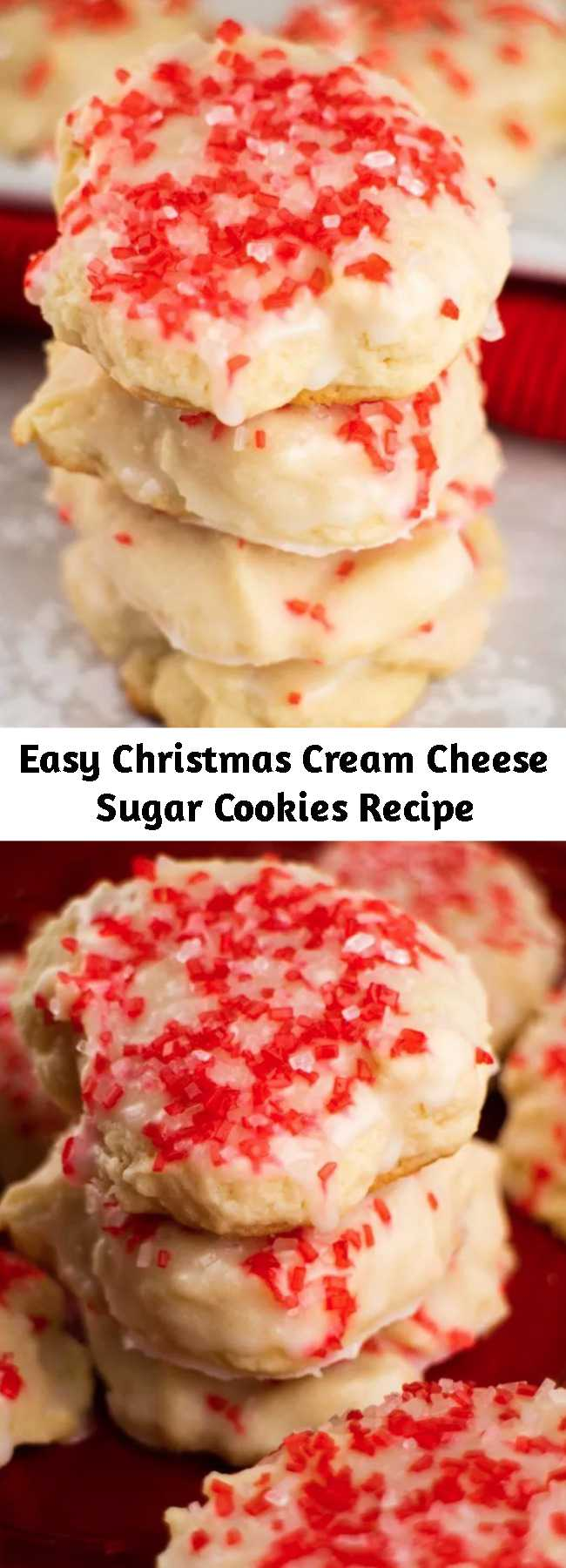 Easy Christmas Cream Cheese Sugar Cookies Recipe - CREAM CHEESE Christmas Sugar Cookies! These easy to make holiday cookies are so soft because they're made with cream cheese! Dip each cookie into vanilla sugar glaze and top with red and white sprinkles!